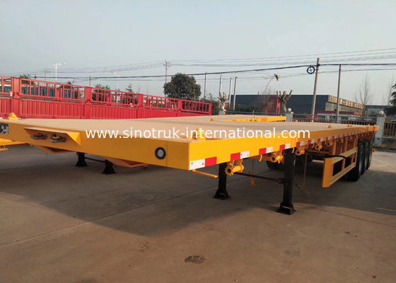 China Yellow Flatbed 3 Axles Container Semi Trailer Truck Carrying Heavy Equipment factory